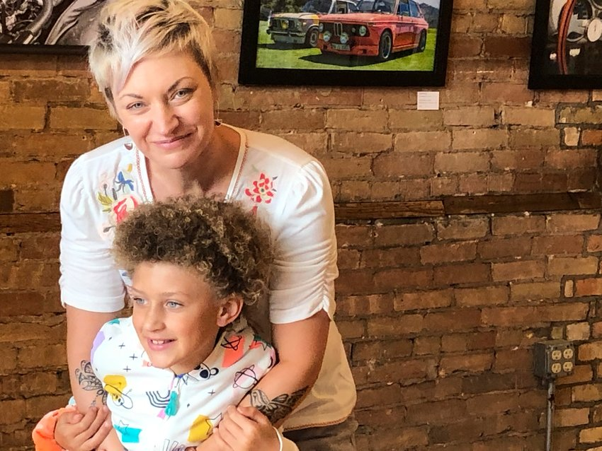 """This Friday, April 28, 2020 photo shows Alexis Arnold, 44, a gallery and gift shop owner in De Pere, Wis., with her 6-year-old daughter Jade Arnold. Arnold has watched and worried all summer as protests over racial injustice at times spiraled to violence. First, she called friends in Portland for firsthand accounts. After it happened in Kenosha, a place not unlike the suburb where she's raising her daughter, she wondered out loud, """"Why are we so broken right now?"""" (AP Photo/Kathleen Hennessey)"""