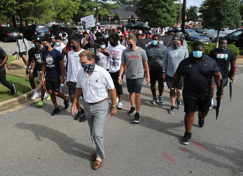 Coach Nick Saban leads the University of Alabama football team and other student athletes Monday, Aug. 31, 2020, in Tuscaloosa, Ala., as they march to Fosters Auditorium, the sight of the famous stand in the Schoolhouse Door to voice their support for social justice. (Gary Cosby Jr./The Tuscaloosa News via AP)