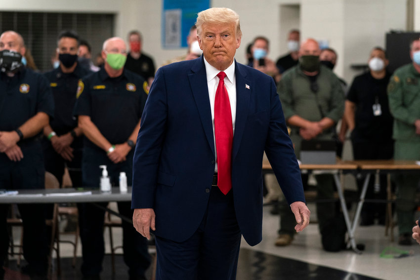 President Donald Trump tours an emergency operations center and meets with law enforcement officers at Mary D. Bradford High School, Tuesday, Sept. 1, 2020, in Kenosha, Wis. (AP Photo/Evan Vucci)..