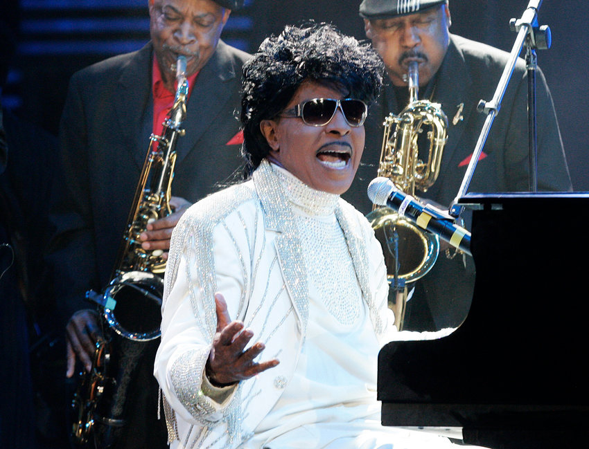 """FILE - In this May 30, 2009 file photo, Little Richard performs at The Domino Effect, a tribute concert to New Orleans rock and roll musician Fats Domino, at the New Orleans Arena in New Orleans.  Little Richard, the self-proclaimed """"architect of rock 'n' roll"""" whose piercing wail, pounding piano and towering pompadour irrevocably altered popular music while introducing black R&B to white America, has died Saturday, May 9, 2020.(AP Photo/Patrick Semansky, File)"""