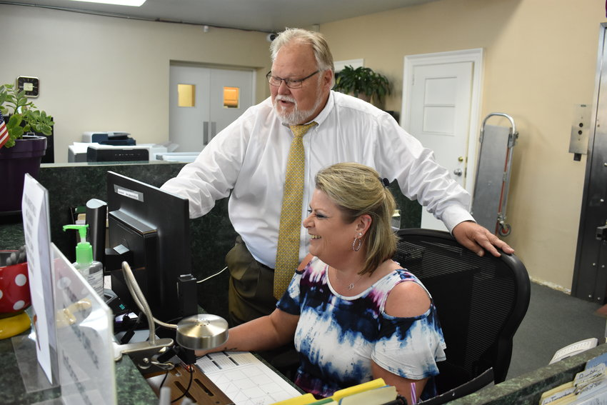 Probate Judge A. Lee Tucker checks out details at a clerk's computer in a May 2019 photo. A proposed local amendment on Nov. 3 would allow Tucker and future trained lawyers serving as probate judge to have equity with the circuit courts in deciding probate court cases.