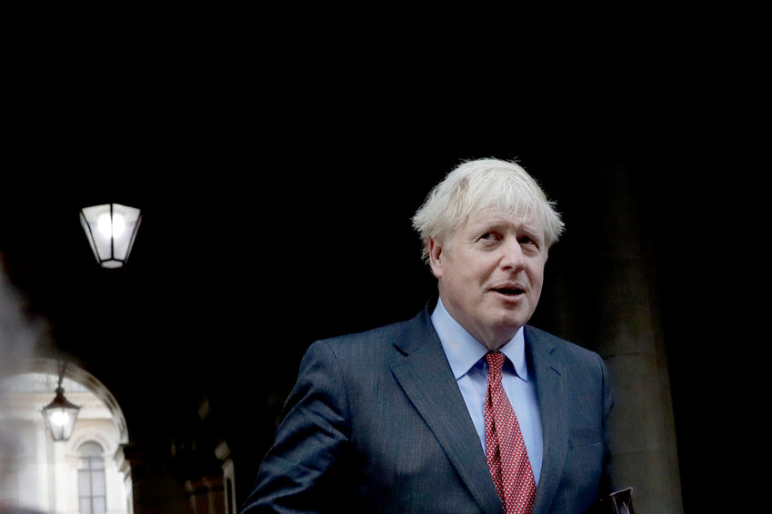 British Prime Minister Boris Johnson walks back into Downing Street after attending a cabinet meeting at the Foreign and Commonwealth Office in London, Tuesday, Sept. 22, 2020. Johnson plans to announce new restrictions on social interactions Tuesday as the government tries to slow the spread of COVID-19 before it spirals out of control. (AP Photo/Matt Dunham)..