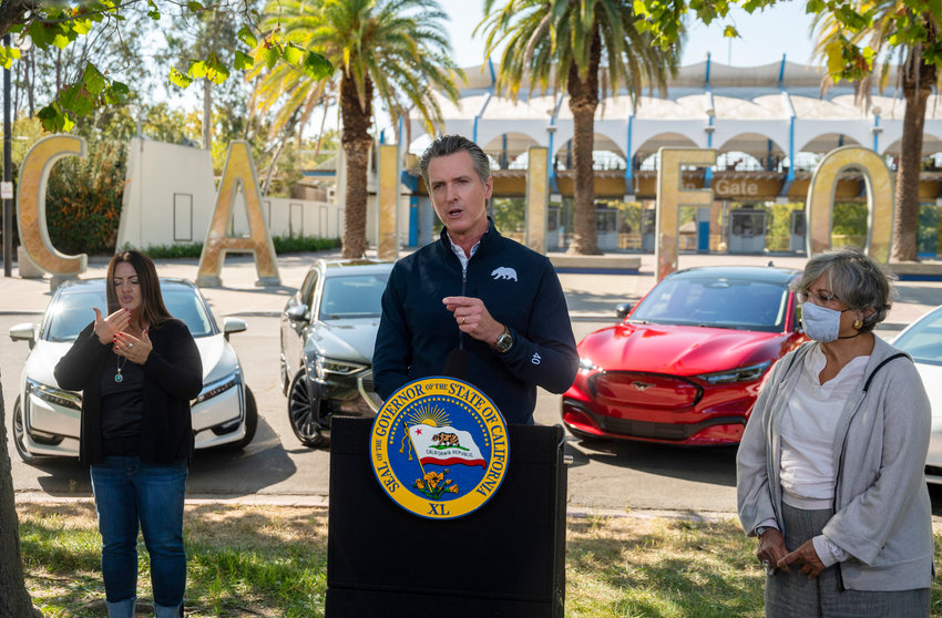 California Gov. Gavin Newsom speaks at a press conference on Wednesday, Sept. 23, 2020, at Cal Expo in Sacramento where he announced an executive order requiring the sale of all new passenger vehicles to be zero-emission by 2035, a move the governor says would achieve a significant reduction in greenhouse gas emissions. California would be the first state with such a rule, though Germany and France are among 15 other countries that have a similar requirement. (Daniel Kim/Sacramento Bee, Pool via AP)