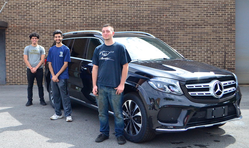 Bevill State Community College-Sumiton students, from left to right, Jacob Danner, Daniel Fazli and Donnie Sexton are pictured with an SUV that Mercedes-Benz recently donated to the college. The three students are currently participating in the Mercedes-Benz Tech Co-Op Program, a partnership between the college and Mercedes.