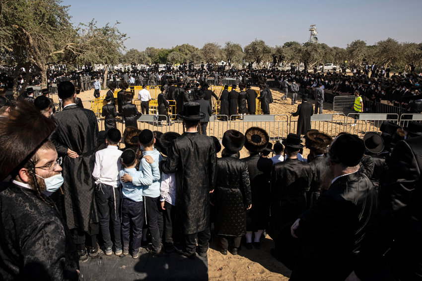 Ultra-Orthodox Jews gather for the funeral for Rabbi Mordechai Leifer, in the port city of Ashdod, Israel, Monday, Oct. 5, 2020. (AP Photo/Tsafrir Abayov)