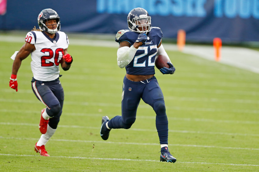Tennessee Titans running back Derrick Henry (22) beats Houston Texans strong safety Justin Reid (20) as Henry runs 94 yards for a touchdown in the second half of an NFL football game Sunday, Oct. 18, 2020, in Nashville, Tenn. (AP Photo/Wade Payne)