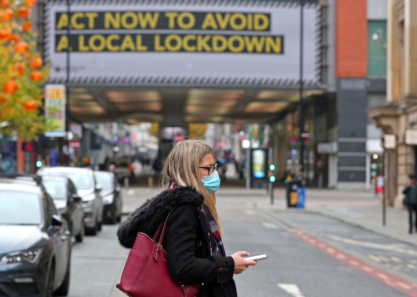 A woman wearing a face mask in Manchester city centre as the row over Greater Manchester's coronavirus status continues. PA Photo. Picture date: Monday October 19, 2020. Greater Manchester's leaders have resisted moving into Tier 3, which would see pubs and bars ordered to close as part of a package of strict measures. See PA story HEALTH Coronavirus. Photo credit should read: Peter Byrne/PA Wire