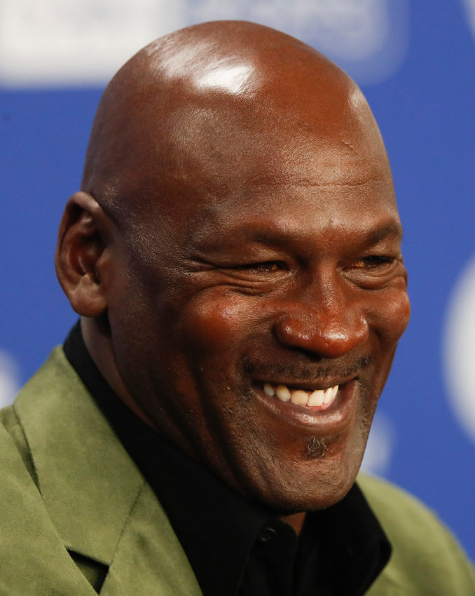 FILE - In this Jan. 24, 2020 file photo, former basketball superstar Michael Jordan speaks during a news conference ahead of NBA basketball game between Charlotte Hornets and Milwaukee Bucks in Paris. DraftKings shares jumped 4% in morning trading, Wednesday, Sept. 2, 2020 after announcing that Jordan would take an ownership stake in the company in exchange for becoming a special adviser to the sports betting site. (AP Photo/Thibault Camus, File)