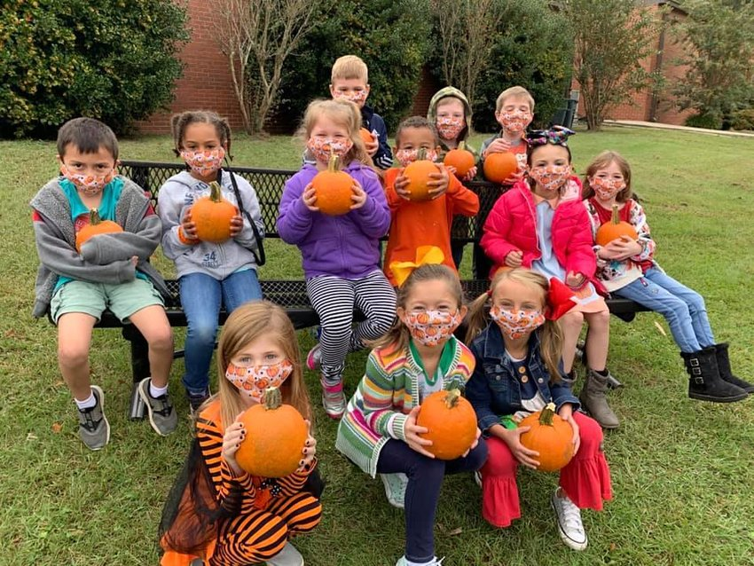 Kindergarten students at T.R. Simmons Elementary school did not miss out on the tradition of picking out a pumpkin for Halloween this year. School field trips are not occurring this year due to COVID-19, so students couldn't make their annual visit to an area pumpkin patch. However, local farmer Drake McKenzie delivered over 400 pumpkins to the school last week, and the front lawn of T.R. Simmons was turned into the Little Vikes' Pumpkin Patch. HallieGrace Muncher coordinated the pumpkin patch festivities, while Stacie Woods arranged for the Sugar Shack to come by the school and give every staff member and student a snow cone, provided by the school's parent involvement team.