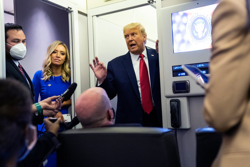 President Donald Trump talks with reporters on Air Force One after participating in the final presidential debate, Thursday, Oct. 22, 2020, in Nashville. (AP Photo/Evan Vucci)..
