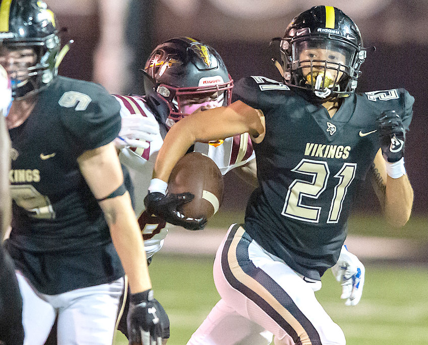 Jasper's Curtis Cavett picks up yardage after intercepting a pass against Pinson Valley during their region game on Friday night. Cavett also had a fumble recovery in the Vikings' 55-33 loss.