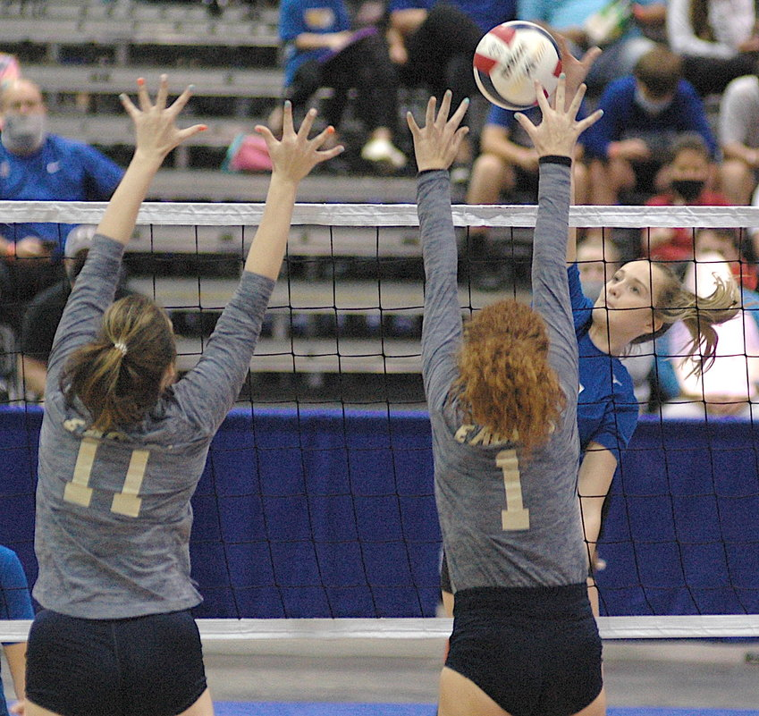Curry's Grayson Evans goes up for a spike against Jacksonville during their Class 4A Super Regional Tournament semifinal match Friday in Huntsville.