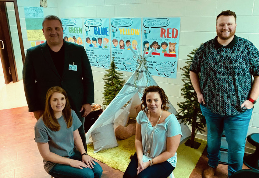 Pictured is one of the calm camps recently created at Parrish Elementary School. Behavioral interventionist Anthony Sellers, at far right, is pictured next to Walker County Schools Mental Health Director Misty Whisenhunt and Parrish school leaders.