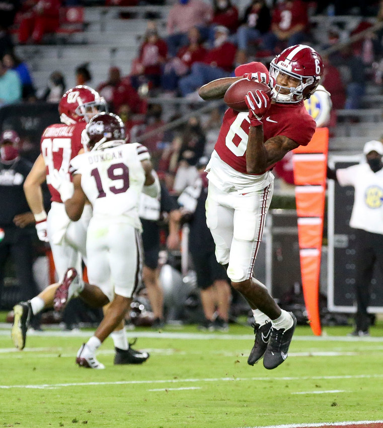 Alabama wide receiver DeVonta Smith (6) catches a touchdown pass with Mississippi State cornerback Emmanuel Forbes (13) defending during an NCAA college football game in Tuscaloosa, Ala., Saturday, Oct. 31, 2020. (Gary Cosby Jr./The Tuscaloosa News via AP)