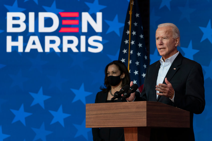Democratic presidential candidate former Vice President Joe Biden joined by Democratic vice presidential candidate Sen. Kamala Harris, D-Calif., speaks at the The Queen theater Thursday, Nov. 5, 2020, in Wilmington, Del. (AP Photo/Carolyn Kaster)