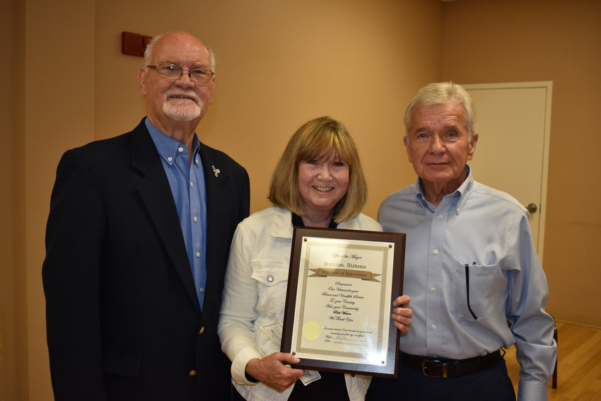 Jilda Watson accepts a veterans community service award on behalf of her late husband, Rick Watson, during Wednesday's Sumiton Veterans Day program. Shown with her is Sumiton City Councilman Bill Fowler, left, the organizer of the event, and Mayor Petey Ellis.