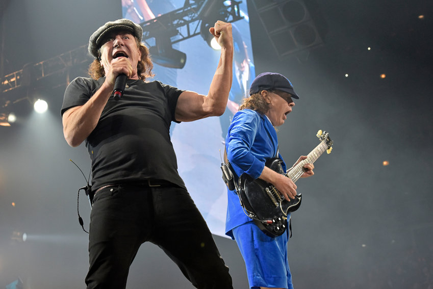 """FILE - Brian Johnson, left, and Angus Young, of AC/DC, perform on the Rock or Bust Tour on Feb. 17, 2016, in Chicago.  After 47 years, the band is releasing its 17th studio album, """"Power Up,"""" on Friday. (Photo by Rob Grabowski/Invision/AP, File)"""