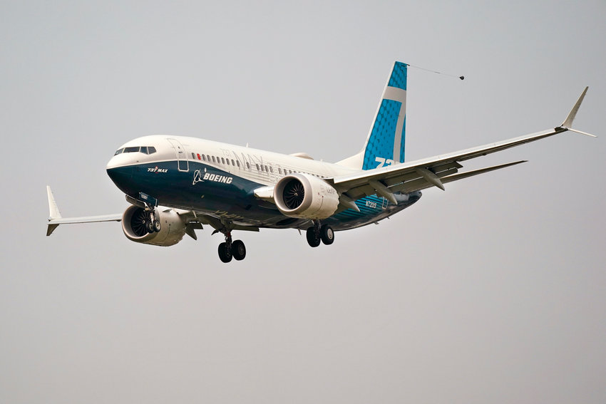 A Boeing 737 MAX jet, piloted by Federal Aviation Administration (FAA) chief Steve Dickson, prepares to land at Boeing Field following a test flight Wednesday, Sept. 30, 2020, in Seattle. The MAX was grounded worldwide in early March 2019 after the second of two fatal accidents that together killed 346 people aboard almost-new aircraft. (AP Photo/Elaine Thompson)