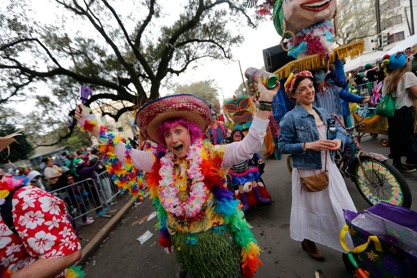 FILE - In this Feb. 13, 2018, file photo, a member of the walking club Mondo Kayo revels as they march and dance down the route of the Krewe of Zulu parade on Mardi Gras day in New Orleans. A New Orleans spokesman says there won't be any parades on Mardi Gras or during the weeks leading up to it because they can't fit within crowd restrictions to slow the spread of the coronavirus pandemic. Beau Tidwell said Tuesday, Nov. 17, 2020, there's just no way to put on a traditional parade without violating the 250-person limit on outdoor crowds. (AP Photo/Gerald Herbert, File)