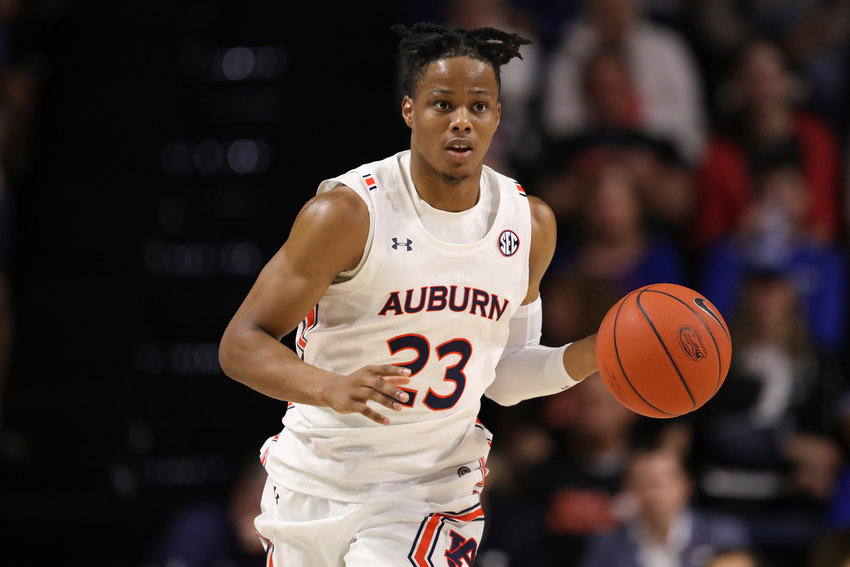 Auburn forward Isaac Okoro (23) dribbles up court against Florida during the first half of an NCAA college basketball game Saturday, Jan. 18, 2020, in Gainesville, Fla. (AP Photo/Matt Stamey)