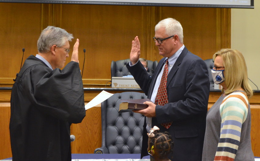 Brad Ingle is sworn in for his third term as chairman of the Walker County Board of Education.