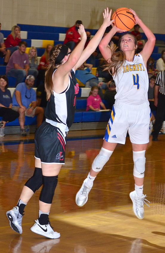 Curry's Alayna Key (4) shoots during the Yellow Jackets' game against Lynn in the Curry Thanksgiving Tournament on Saturday.