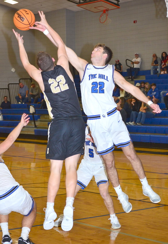 Carbon Hill's Josh Kilgore, right, battles Lamar County's Ty Estridge, left, for a rebound during their game at Carbon Hill High School on Monday. Carbon Hill won the game 60-46. The Bulldogs face Sulligent at 3 p.m. today.