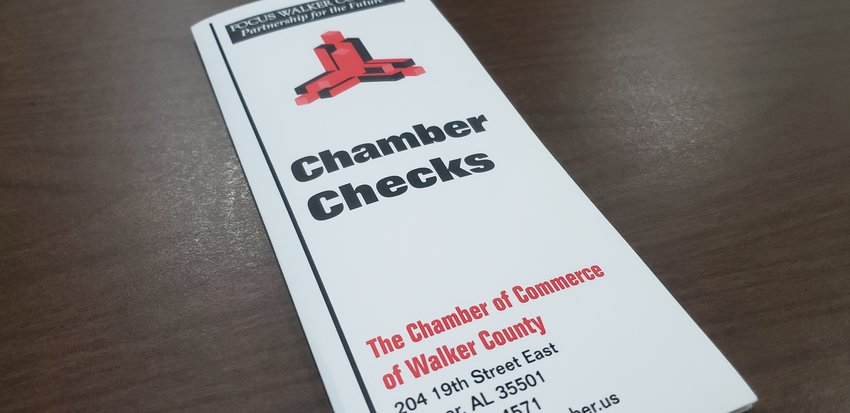 An envelope containing Chamber Checks from the Chamber of Commerce of Walker County. Checks are available as gift certificates to local member businesses to help keep people spending their money in Walker County.