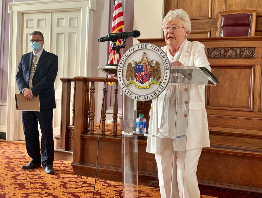 Alabama Gov. Kay Ivey, right, and State Health Officer Scott Harris announce the extension of a state order requiring face masks in public during a press conference, Wednesday, July 29, 2020, in Montgomery, Alabama. Ivey extended a state order requiring face coverings in public for another month and expanded it to include students in grade 2 and above in an attempt to slow the spread of COVID-19 as schools reopen. (AP Photo/Kim Chandler)