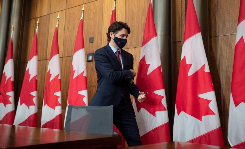 Prime Minister Justin Trudeau leaves a news conference in Ottawa, Monday, Dec. 7, 2020.  (Adrian Wyld/The Canadian Press via AP)
