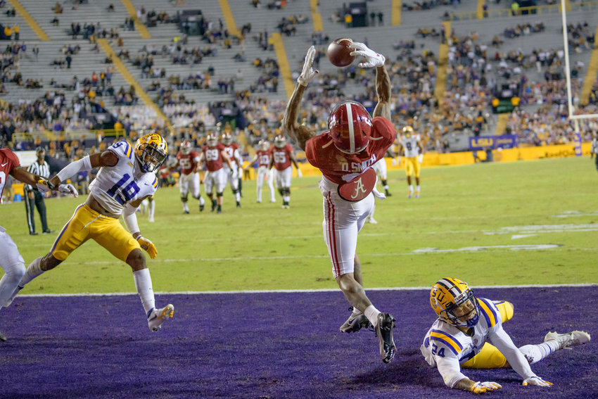 Alabama wide receiver DeVonta Smith (6) makes a touchdown grab against LSU cornerback Derek Stingley Jr. (24) during the first half of an NCAA college football game in Baton Rouge, La., Saturday, Dec. 5, 2020. (AP Photo/Matthew Hinton)