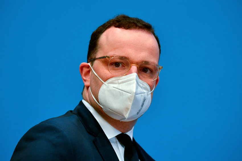 German Health Minister Jens Spahn wears a face mask as he arrives for a press conference in Berlin, Germany, Tuesday, Dec. 15, 2020 in Berlin on the new coronavirus Covid-10 pandemic. (Tobias Schwarz/Pool Photo via AP)