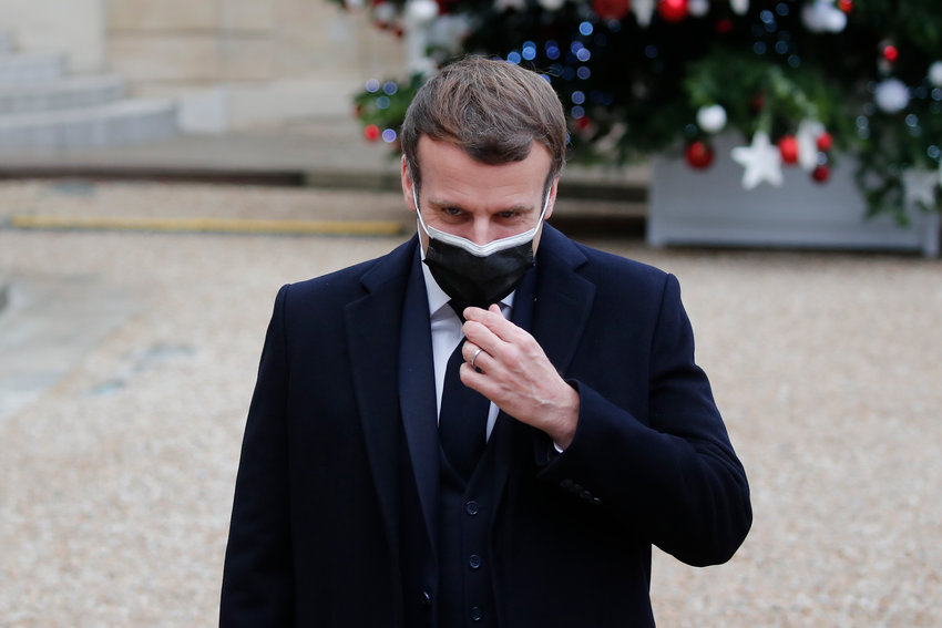 French President Emmanuel Macron reacts as he meets Portuguese Prime Minister Antonio Costa, Wednesday, Dec. 16, 2020 in Paris. French President Emmanuel Macron has tested positive for COVID-19, the presidential Elysee Palace announced on Thursday. (AP Photo/Francois Mori)