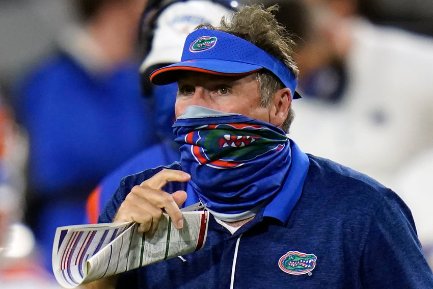 Florida head coach Dan Mullen, right, pauses during a timeout against Georgia during the second half of an NCAA college football game, Saturday, Nov. 7, 2020, in Jacksonville, Fla. (AP Photo/John Raoux)