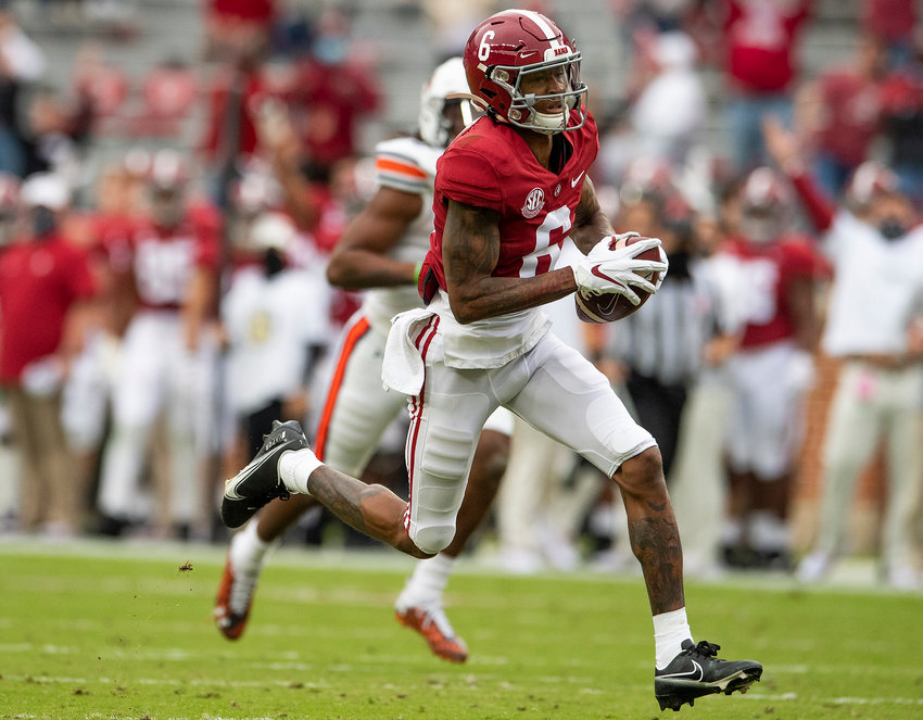 Nov 28, 2020; Tuscaloosa, Alabama, USA;  Alabama wide receiver DeVonta Smith (6) catches an early touchdown pass against Auburn at Bryant-Denny Stadium in the Iron Bowl. Mandatory Credit: Mickey Welsh/The Montgomery Advertiser via USA TODAY Sports