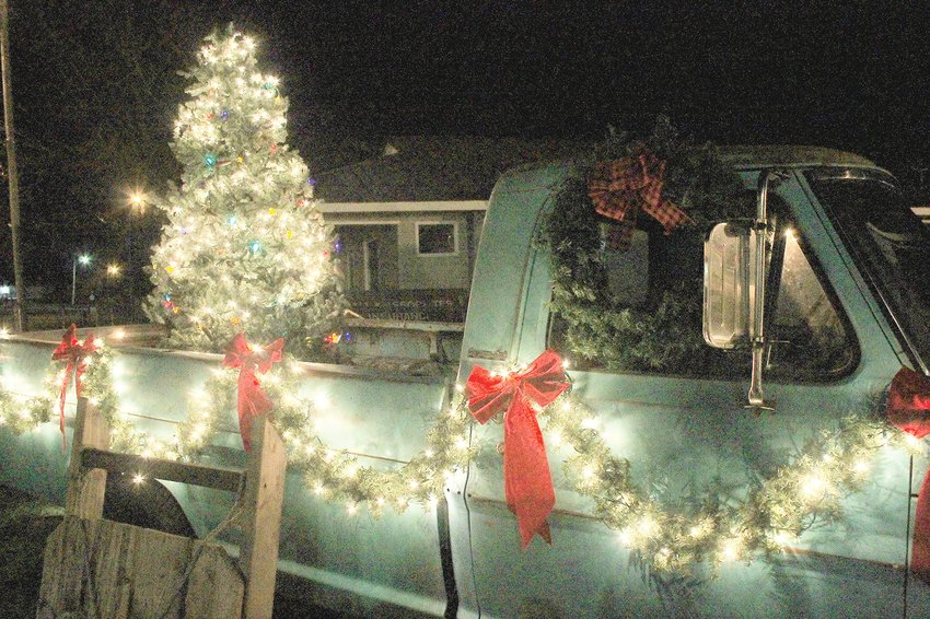 The people of Walker County have gone through some dark times this year, but the lights of Christmas are shining now in yards, businesses and downtowns. A vintage Chevrolet is decked out for Christmas in front of the Carbon Hill Municipal Building.