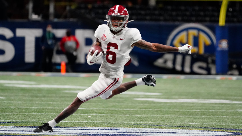 Alabama wide receiver DeVonta Smith (6) runs against Florida during the first half of the Southeastern Conference championship NCAA college football game, Saturday, Dec. 19, 2020, in Atlanta. (AP Photo/Brynn Anderson)