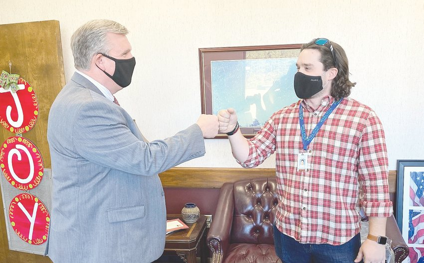 Dr. Joel Hagood, the new president of Bevill State Community College (effective Jan. 1), shares a fist bump with BSCC recruiter Cole Richards during one of his campus visits last week.