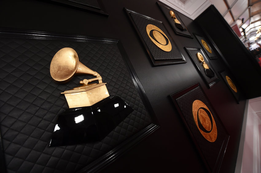 FILE - A view of the red carpet appears prior to the start of the 62nd annual Grammy Awards on Jan. 26, 2020, in Los Angeles. The Recording Academy told The Associated Press on Tuesday, Jan 5. 2021, that the 63rd annual Grammy Awards will no longer take place on its original Jan. 31, 2021, date in Los Angeles and will broadcast in March due to a recent surge in coronavirus cases and deaths.  (Photo by Jordan Strauss/Invision/AP, File)
