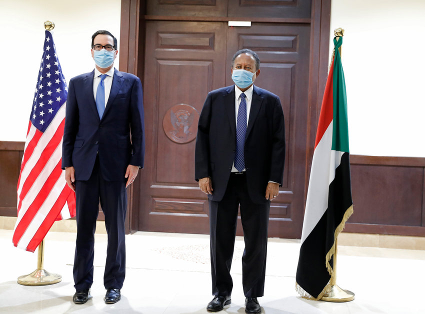 Sudanese Prime Minister Abdullah Hamdok (R) welcomes US Treasury Secretary Stephen Mnuchin (L) to the Cabinet Building.Treasury Secretary Stephen Mnuchin  is on a 1-day official visit to Sudan to meet with al-Burhan and other government officials.   in Khartoum, Sudan, Wednesday, Jan.. 6, 2021. (AP Photo/)