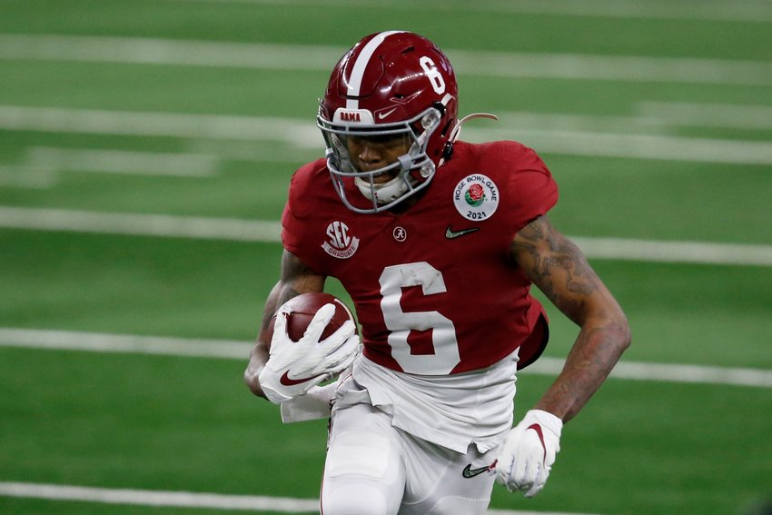 Alabama wide receiver DeVonta Smith (6) gains yardage after a catch in the first half of the Rose Bowl NCAA college football game against Notre Dame in Arlington, Texas, Friday, Jan. 1, 2021. (AP Photo/Roger Steinman)