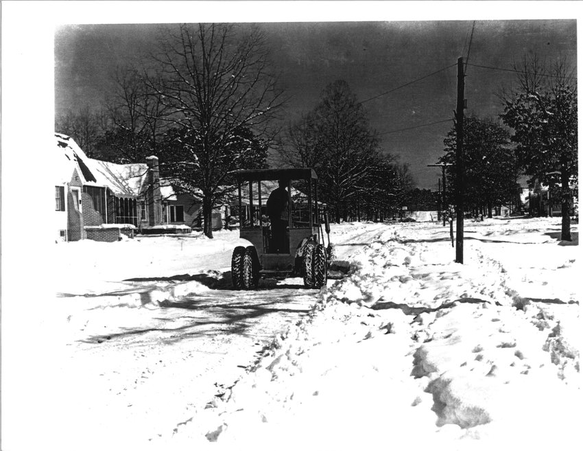 Snow plows clear Jasper's 18th Street in this January 1940 photo taken by Luis Rushing. Walker County was covered in between 14 and 17 inches of snow on Jan. 27, 1940. The snow remained on the ground for 10 days and local creeks and rivers froze as temperatures dipped below zero for a portion of each day. For more photos from the Luis Rushing collection, which is part of the Carl Elliott Regional Library's collection, visit  https://digital.archives.alabama.gov/digital/collection/carlelliott/.