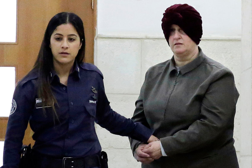 FILE - This Feb. 27, 2018, file photo, Israeli-born Australian Malka Leifer, right, is brought to a courtroom in Jerusalem. Israel's Supreme Court on Tuesday, Dec. 15, 2020, rejected an appeal challenging the extradition of Leifer, a former teacher wanted in Australia accused of sexually abusing several former students at a Jewish school in Melbourne, clearing the way for her to stand trial after a six-year legal saga. Leifer is currently on a plane to Australia, Monday, Jan. 25, 2021. (AP Photo/Mahmoud Illean, File)
