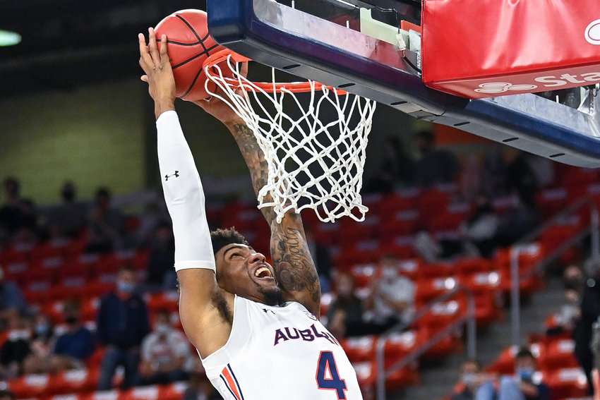 Auburn forward Javon Franklin (4) dunks against Missouri during the first half of an NCAA college basketball game Tuesday, Jan. 26, 2021, in Auburn, Ala. (AP Photo/Julie Bennett)