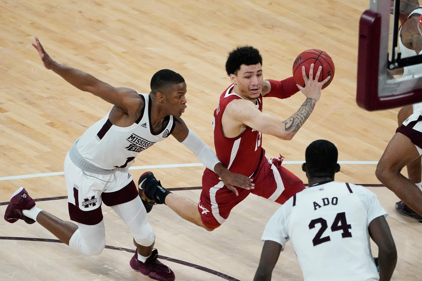 Alabama guard Jahvon Quinerly (13) dribbles past Mississippi State guard Iverson Molinar (1) during the second half of their game in Starkville, Miss., Saturday.