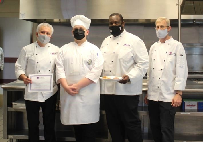 Jasper High School junior Brock Woods, second from left, is pictured after winning a state culinary arts competition.