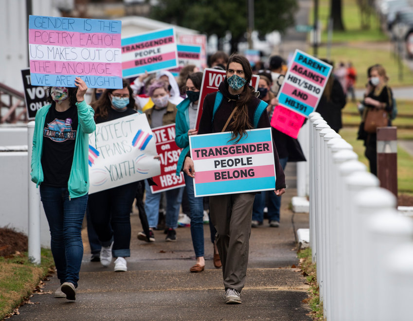 Protestors in support of transgender rights march around the Alabama State House in Montgomery, Ala., on Tuesday, March 2, 2021. (Jake Crandall//The Montgomery Advertiser via AP)