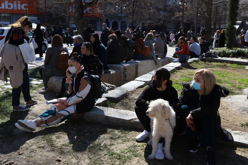 People gather at the main square after an earthquake in Larissa city, central Greece, Wednesday, March 3, 2021. The earthquake with a preliminary magnitude of over 6.0 has struck central Greece and was felt as far away as the capitals of neighboring Albania, North Macedonia, Kosovo and Montenegro. (AP Photo/Vaggelis Kousioras)