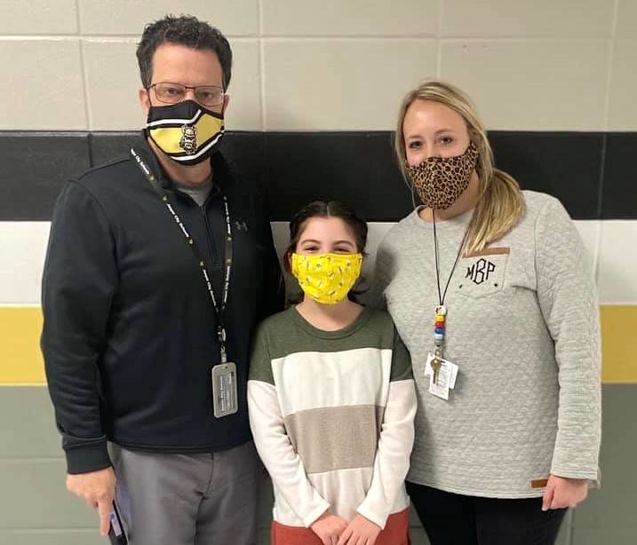 Maddox Intermediate School student Abbie Madison, at center, is pictured after winning the Walker County Spelling Bee. Maddox principal Marc Sargent and Maddox librarian Molly Bailey are also pictured.