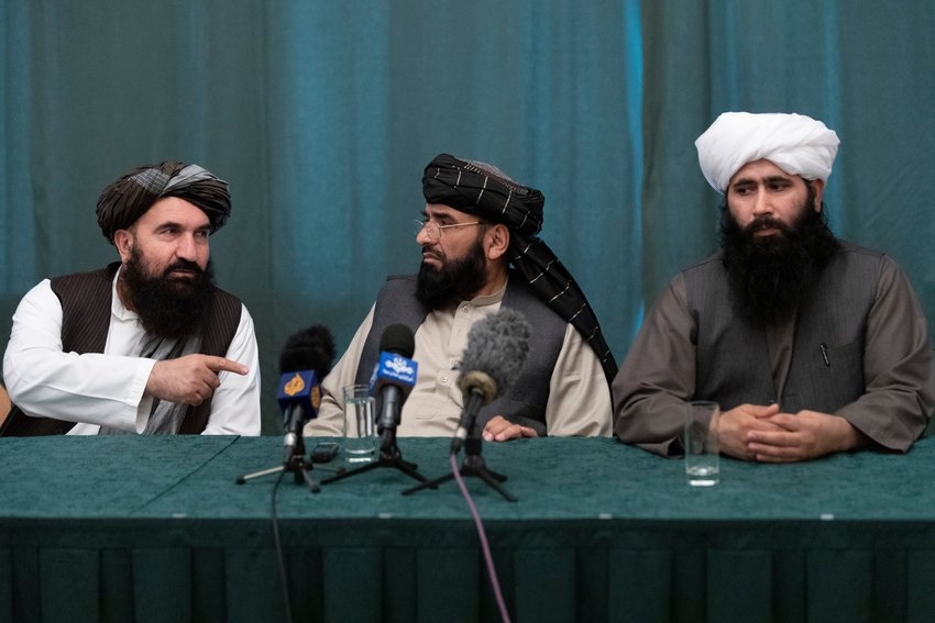 "Members of the Taliban delegation from the left: Khairullah Khairkhwa, former western Herat Governor and one of five Taliban released from the U.S. prison on Guantanamo Bay in exchange for U.S. soldier Bowe Bergdahl, Suhail Shaheen, member of negotiation team, Mohammad Naeem, spokesman for the Taliban's political office attend their joint news conference in Moscow, Russia, Friday, March 19, 2021. The Taliban warned Washington against defying a May 1 deadline for the withdrawal of American and NATO troops from Afghanistan promising a ""reaction"". (AP Photo/Alexander Zemlianichenko, Pool)"